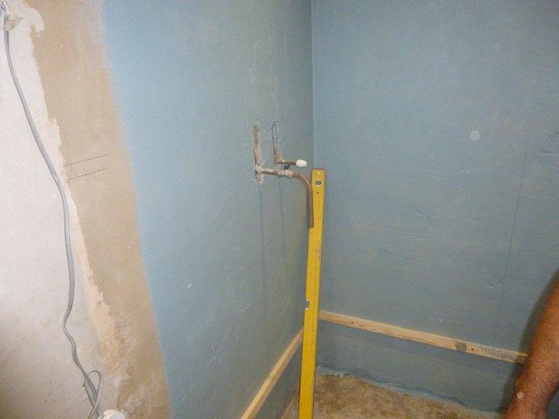 Waterproof walls, prior to tiling.