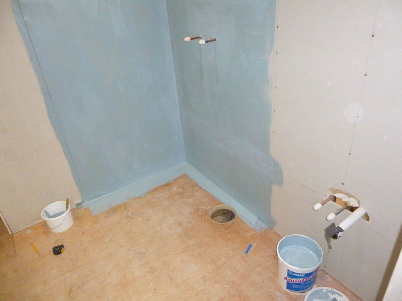 Waterproofing (tanking) of the walls in the shower area.