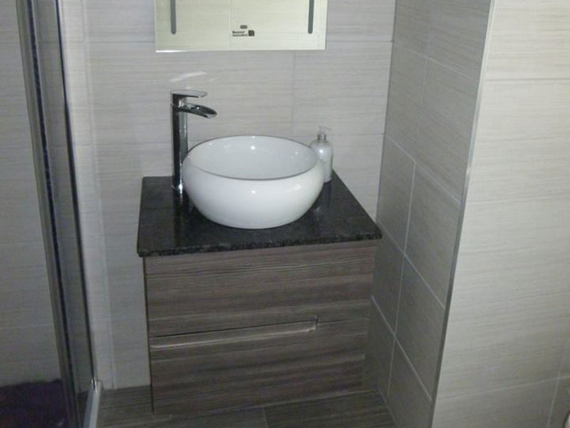 Counter top basin on granite with mirror.