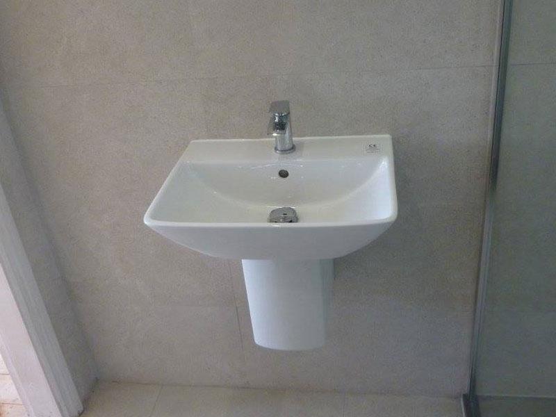 Semi pedestal basin with hidden supplies.