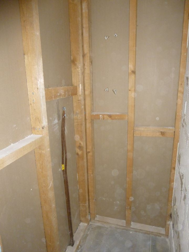 Old shower area, prior to new plasterboarding and tanking of the walls.